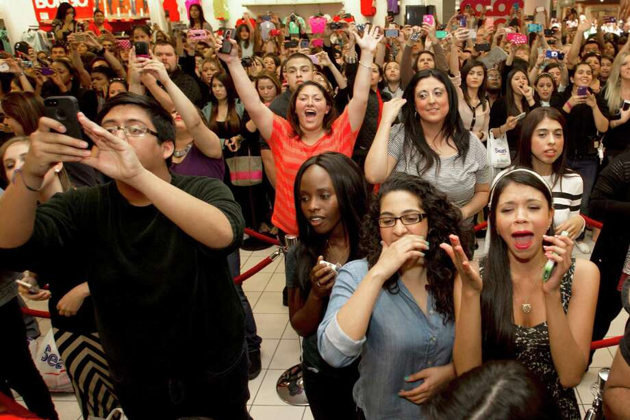 Fans of the Kardashian sisters cheer and take photos as they arrive to an appearance at the Sears Willowbrook Mall Saturday, May 4, 2013, in Houston. The Kardashian sisters appeared before a huge crowd of fans to celebrate the Spring 2013 Kardashian Kollection. Photo: Brett Coomer, Houston Chronicle / © 2013 Houston Chronicle