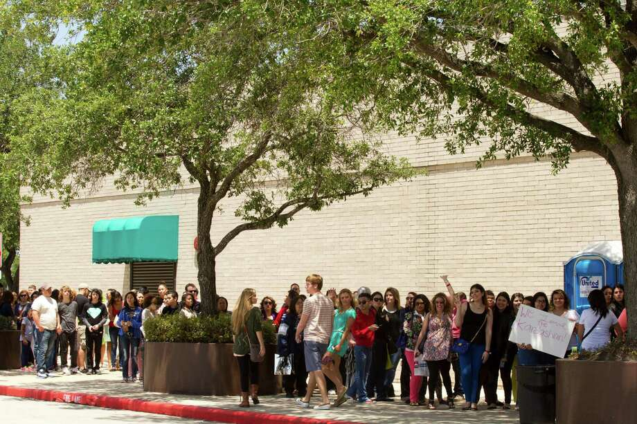 Fans of the Kardashian sisters line up outside the Sears Willowbrook Mall for a chance to see the sisters Saturday, May 4, 2013, in Houston. The Kardashian sisters appeared before a huge crowd of fans to celebrate the Spring 2013 Kardashian Kollection. Photo: Brett Coomer, Houston Chronicle / © 2013 Houston Chronicle