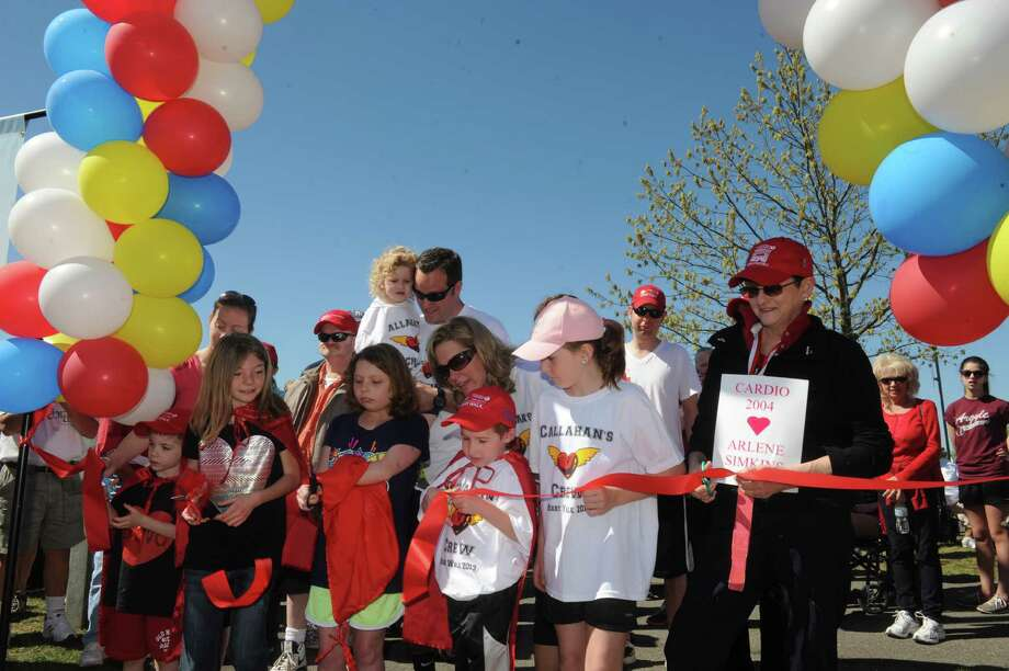 Heart disease survivors cut the ribbon to begin the 21st Capital Region Heart Walk at The Crossings on Saturday May 4, 2013 in Colonie, N.Y. (Michael P. Farrell/Times Union) Photo: Michael P. Farrell