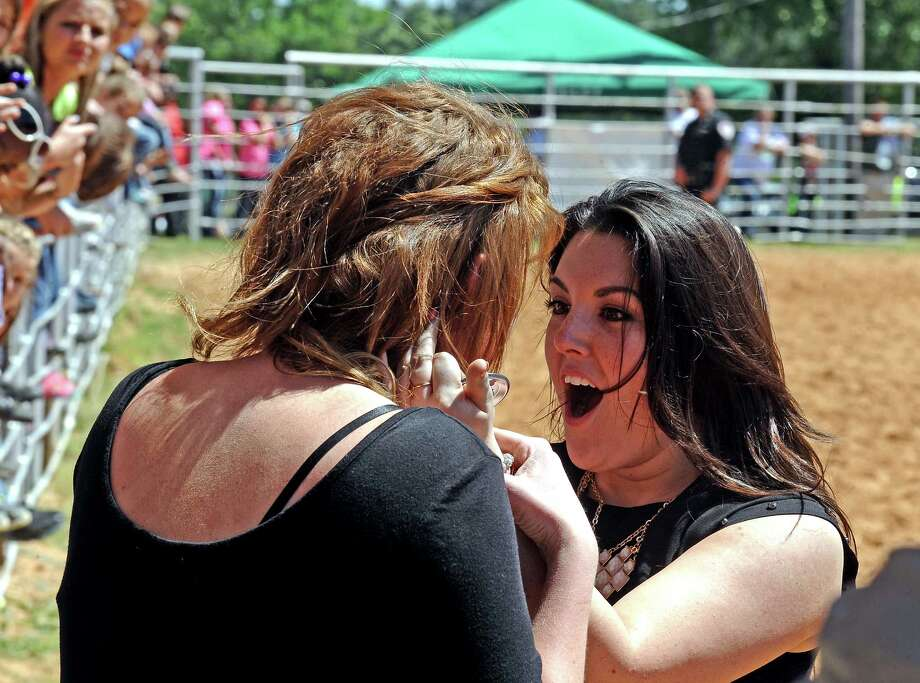 Kree Harrison fans gather at the Tyler County Rodeo Arena outside of Woodville on Saturday, May 4, 2013, to see Harrison perform a song.   Photo taken: Randy Edwards/The Enterprise