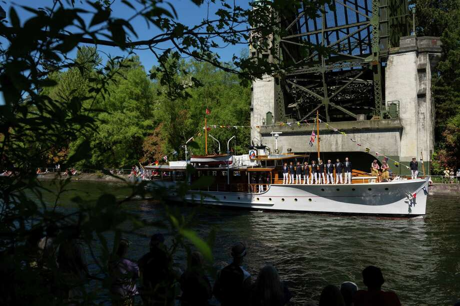 A collection ranging vintage to modern watercraft slowly made their way through the waters of the Montlake Cut following the conclusion of the Windermere Cup Saturday, May 4, 2013, in Seattle. The University of Washington's male and female rowing teams took home the gold in the Windermere Cup. Photo: JORDAN STEAD, SEATTLEPI.COM / SEATTLEPI.COM
