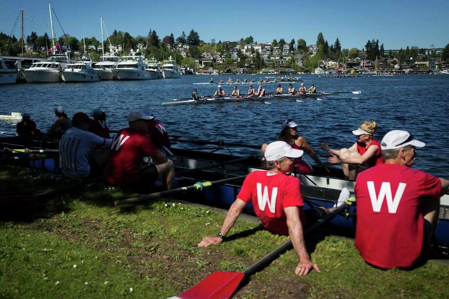 Early finisher teams await the conclusion of the Windermere Cup from the shore Saturday, May 4, 2013, in Seattle. The University of Washington's male and female rowing teams took home the gold in the Windermere Cup. Photo: JORDAN STEAD, SEATTLEPI.COM / SEATTLEPI.COM