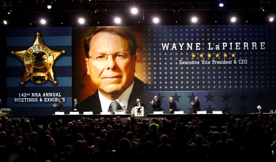 Wayne LaPierre's likeness is broadcast on the stage at the NRA convention in Houston. Photo: Johnny Hanson/Chronicle