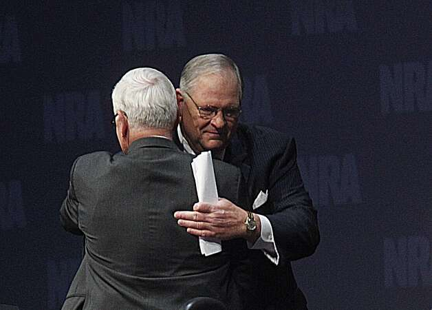 James Porter, the NRA's first VP hugs current president David Keene on Saturday. Photo: Johnny Hanson/Chronicle