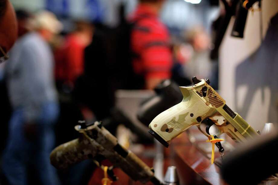A camp painted handgun is seen, during day 1 of the 142nd NRA annual meetings and exhibits, Friday, May 3, 2013 at the George R Brown convention center in  (TODD SPOTH FOR THE CHRONICLE) Photo: © TODD SPOTH, 2013 / © TODD SPOTH, 2013