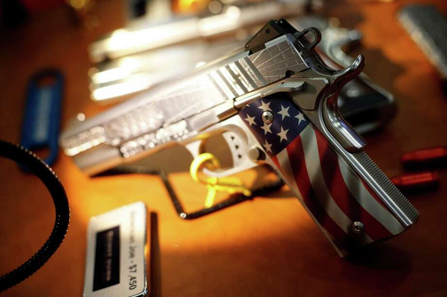 A decorative pistol is seen, during day 1 of the 142nd NRA annual meetings and exhibits, Friday, May 3, 2013 at the George R Brown convention center in  (TODD SPOTH FOR THE CHRONICLE) Photo: © TODD SPOTH, 2013 / © TODD SPOTH, 2013