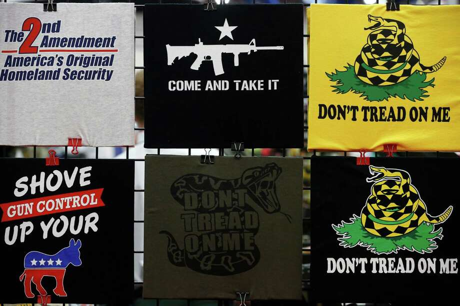 A display of t-shirts for sale is seen, during day 1 of the 142nd NRA annual meetings and exhibits, Friday, May 3, 2013 at the George R Brown convention center in  (TODD SPOTH FOR THE CHRONICLE) Photo: © TODD SPOTH, 2013 / © TODD SPOTH, 2013