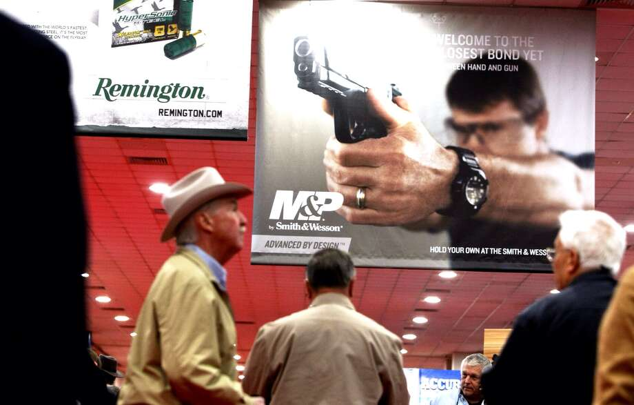 The 2013 NRA convention brought large crowds to Houston's George R. Brown Center, Friday, May 3, 2013. Photo: Johnny Hanson/Chronicle