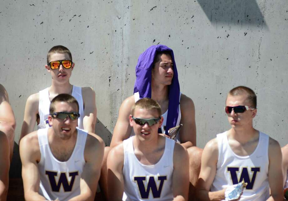 Members of the University of Washington rowing team wait for the award ceremony to start at the 27th Windermere Cup after the 27th Windermere Cup at Union Bay on Saturday, May 4, 2013. The University of Washington men's and women's teams swept all four premier events this year, giving the varsity teams their seventh straight Windermere Cup win. (Photo by Lindsey Wasson) Photo: LINDSEY WASSON, LINDSEY WASSON/SEATTLEPI.COM / SEATTLEPI.COM