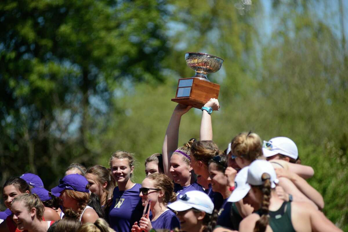 Members of the University of Washington women's junior varsity team hold up the Cascade Cup after the 27th Windermere Cup at Union Bay on Saturday, May 4, 2013. The University of Washington men's and women's teams swept all four premier events this year, giving the varsity teams their seventh straight Windermere Cup win. (Photo by Lindsey Wasson)