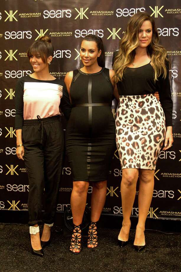 Kourtney, left, Kim and Khloe Kardashian pose for photos as they arrive to an appearance at the Sears Willowbrook Mall Saturday, May 4, 2013, in Houston. The Kardashian sisters appeared before a huge crowd of fans to celebrate the Spring 2013 Kardashian Kollection. ( Brett Coomer / Houston Chronicle ) Photo: Brett Coomer, Staff / © 2013 Houston Chronicle