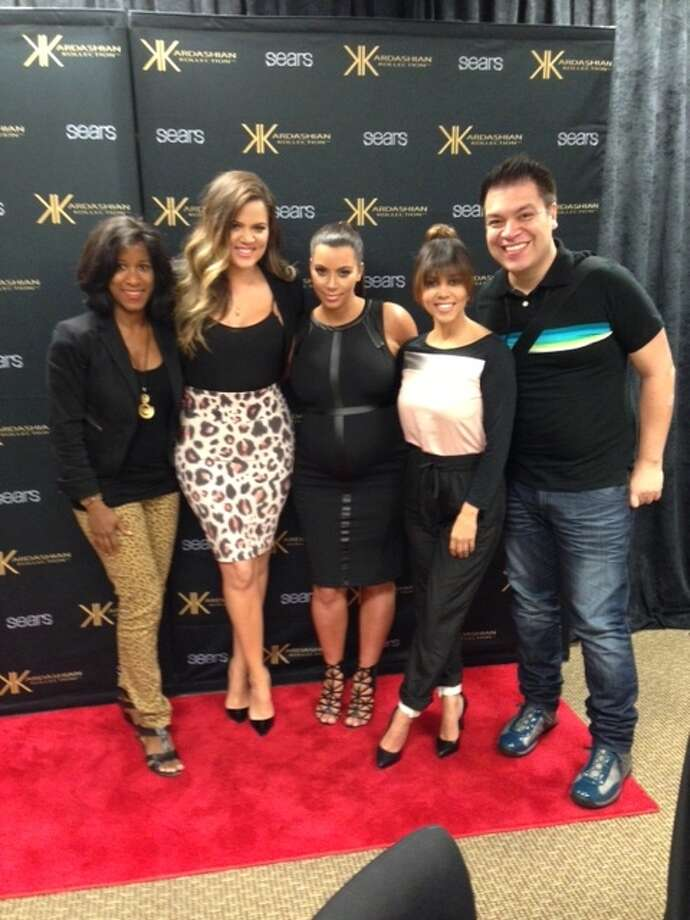 Chronicle's Joy Sewing and Joey Guerra pose with the Kardashians after an interview.