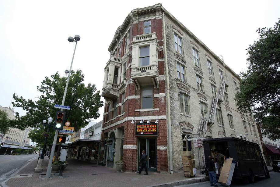 The Reuter Building, 217-219 Alamo Plaza, is the former home to Pizza Hut, and current home to the Mirror Maze. The four-story brick building was designed by architect James Wahrenberger for William Reuter in the early 1890s. Photo: Helen L. Montoya / San Antonio Express-News