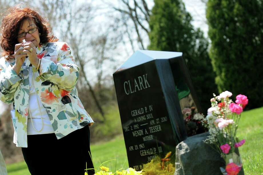 Mary Clark attends a memorial service held at the gravesite of her grandson Jerry Clark IV on Saturday, April 27, 2013, at Calvary Cemetery in Bethlehem, N.Y. Jerry committed suicide at age 17 in April 2010. Since then, the Clark family has been trying to raise awareness about youth mental-health issues and suicide. As well, they continue to work to pass legislation ? Assembly Bill A04054 ? that requires parents or guardians to be informed about the Committee on Special Education referral process, prior to school suspensions of more than 5 days. (Cindy Schultz / Times Union) Photo: Cindy Schultz / 10022162A