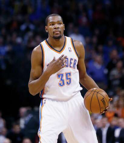 Oklahoma City Thunder forward Kevin Durant (35) gestures to his team during an NBA basketball game against the Memphis Grizzlies in Oklahoma City, Thursday, Jan. 31, 2013. Oklahoma City won 106-89. (AP Photo/Sue Ogrocki) Photo: Associated Press / AP