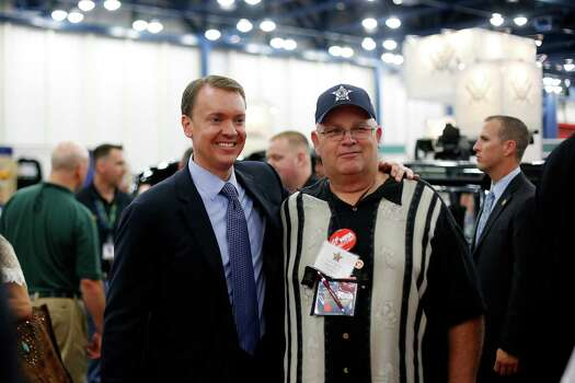 NRA-ILA Executive Director Chris Cox poses with an NRA member, during day 2 of the 142nd NRA annual meetings and exhibits, Saturday, May 4, 2013 at the George R Brown convention center in Houston, Texas. (TODD SPOTH FOR THE CHRONICLE) Photo: © TODD SPOTH, 2013 / © TODD SPOTH, 2013