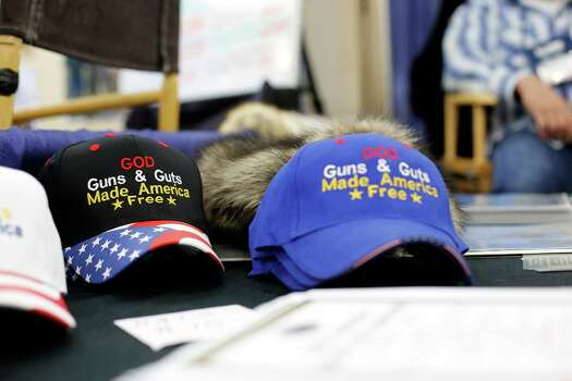 A table selling patriotic hats is seen, during day 2 of the 142nd NRA annual meetings and exhibits, Saturday, May 4, 2013 at the George R Brown convention center in Houston, Texas. (TODD SPOTH FOR THE CHRONICLE) Photo: © TODD SPOTH, 2013 / © TODD SPOTH, 2013