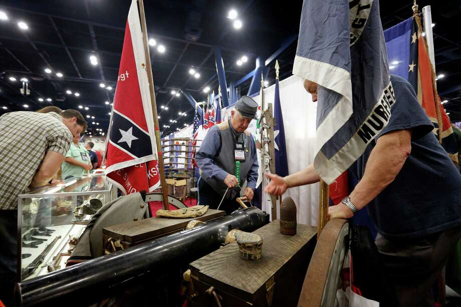 Kirk Stanley of the North South Skirmish Association shows off Civil War era cannons, during day 2 of the 142nd NRA annual meetings and exhibits, Saturday, May 4, 2013 at the George R Brown convention center in Houston, Texas. (TODD SPOTH FOR THE CHRONICLE) Photo: © TODD SPOTH, 2013 / © TODD SPOTH, 2013