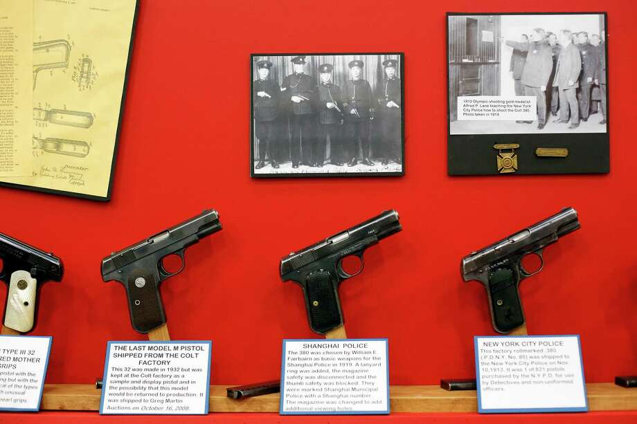 A display showcasing vintage Colt pistols is seen, during day 2 of the 142nd NRA annual meetings and exhibits, Saturday, May 4, 2013 at the George R Brown convention center in Houston, Texas. (TODD SPOTH FOR THE CHRONICLE) Photo: © TODD SPOTH, 2013 / © TODD SPOTH, 2013