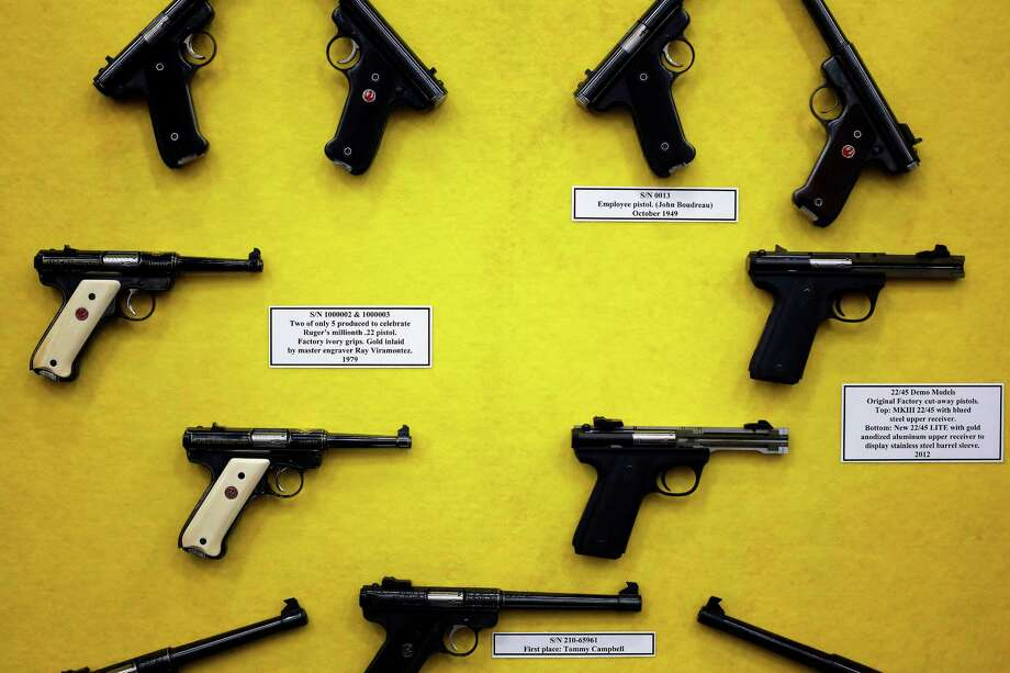 A display of vintage pistols is seen, during day 2 of the 142nd NRA annual meetings and exhibits, Saturday, May 4, 2013 at the George R Brown convention center in Houston, Texas. (TODD SPOTH FOR THE CHRONICLE) Photo: © TODD SPOTH, 2013 / © TODD SPOTH, 2013