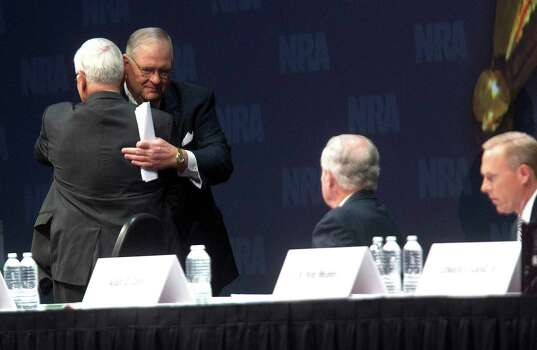 NRA President David A. Keene, right, gives first vice president, Jim Porter a hug during the NRA Annual Meeting of Members at the National Rifle Association's 142 Annual Meetings and Exhibits in the George R. Brown Convention Center Saturday, May 4, 2013, in Houston. Photo: Johnny Hanson, Houston Chronicle / © 2013  Houston Chronicle