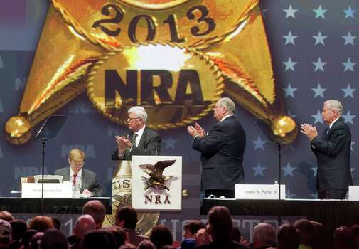 NRA leadership including NRA President David A. Keene, left, first vice president, James Porter and second vice president, Allan Cors applaud executive director Wayne LaPierre during the NRA Annual Meeting of Members at the National Rifle Association's 142 Annual Meetings and Exhibits in the George R. Brown Convention Center Saturday, May 4, 2013, in Houston. Photo: Johnny Hanson, Houston Chronicle / © 2013  Houston Chronicle