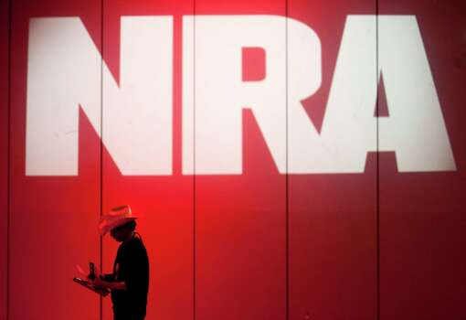 An NRA member makes his way into the NRA Annual Meeting of Members at the National Rifle Association's 142 Annual Meetings and Exhibits in the George R. Brown Convention Center Saturday, May 4, 2013, in Houston. Photo: Johnny Hanson, Houston Chronicle / © 2013  Houston Chronicle