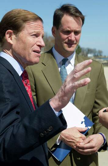 Senator Richard Blumenthal, left, and Congressman Jim Himes, right, talk about damage from Hurricane