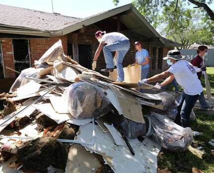 Texas A&M  students help remove debris at a home in West on Saturday. The home was damaged by an explosion at the West Fertilizer plant on April 17. Photo: Rod Aydelotte, MBO / Waco Tribune Herald