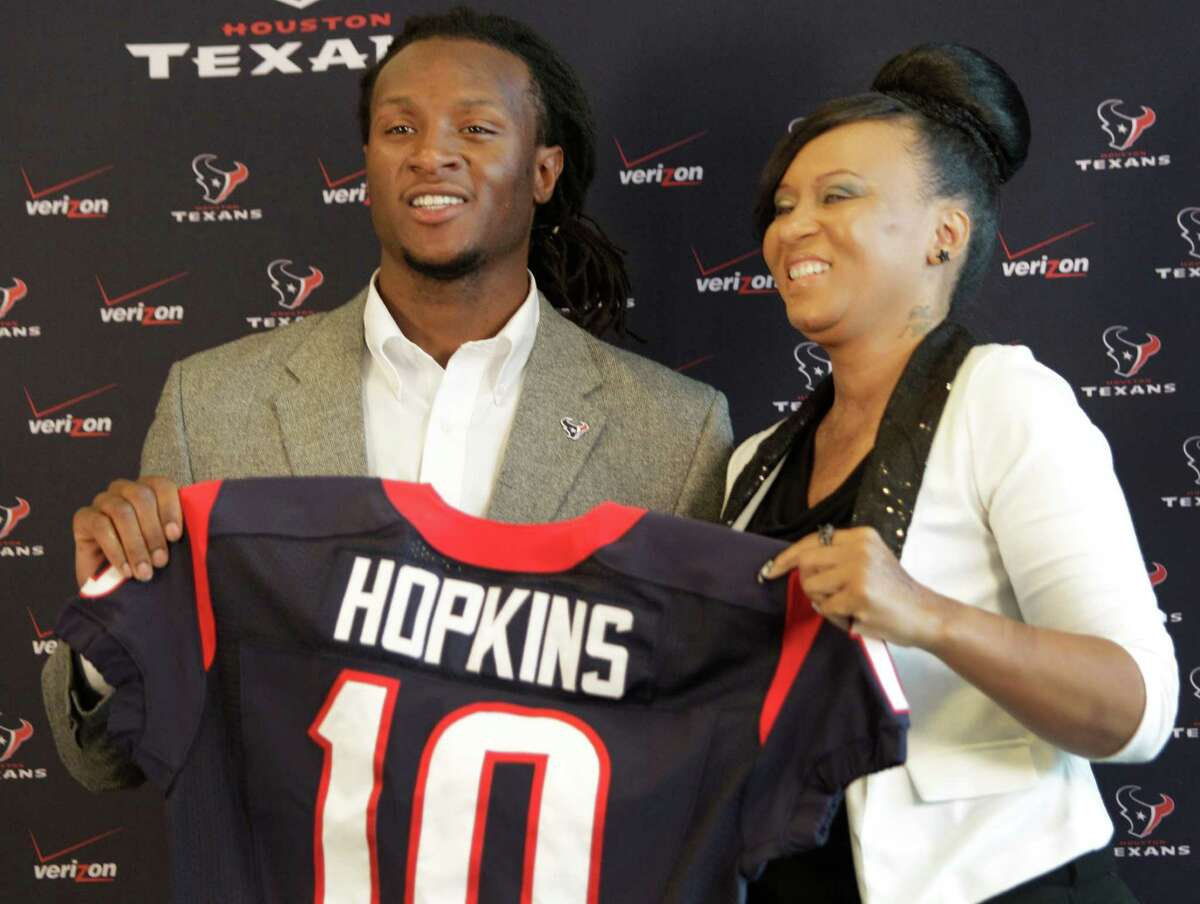 Houston Texans first-round draft pick DeAndre Hopkins enjoys the moment with his mother, Sabrina Greenlee, at Reliant Stadium. She and her family have endured tragedies, but now,