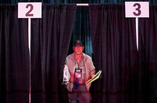 Tom Egelston of Spring exits a voting booth at the NRA Annual Meeting of Members at the National Rifle Association's 142 Annual Meetings and Exhibits in the George R. Brown Convention Center Saturday, May 4, 2013, in Houston. Photo: Johnny Hanson, Houston Chronicle / © 2013  Houston Chronicle