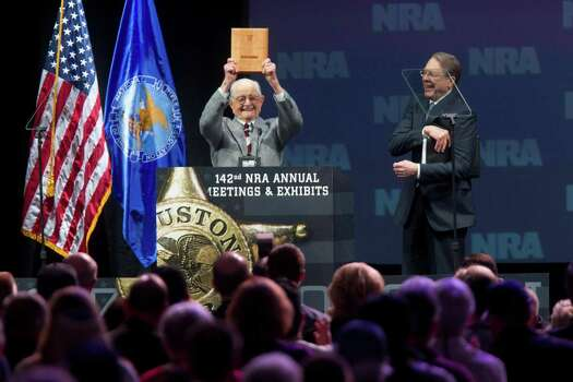 Born in 1917, the oldest life NRA member in attendance, Wayne Burd, holds up the plaque he received for being a member since 1938 next to Wayne LaPierre, executive vice president of the NRA during the NRA Annual Meeting of Members at the National Rifle Association's 142 Annual Meetings and Exhibits in the George R. Brown Convention Center Saturday, May 4, 2013, in Houston. Photo: Johnny Hanson, Houston Chronicle / © 2013  Houston Chronicle