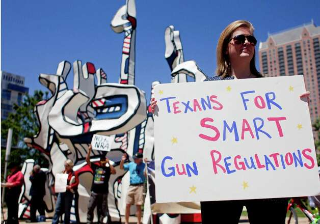 Jolyn Brand of Friendswood, with the group Texans for Smart Gun Regulation, stands outside of the National Rifle Association's 142 Annual Meetings and Exhibits in the George R. Brown Convention Center Saturday, May 4, 2013, in Houston. Photo: Johnny Hanson, Houston Chronicle / © 2013  Houston Chronicle