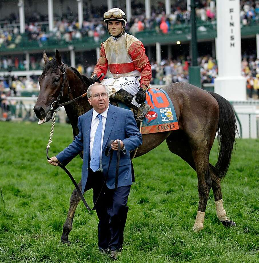 LOUISVILLE, KY - MAY 04:  Trainer Shug McGaughey (L) walks with Orb ridden by jockey Joel Rosario after winning the 139th running of the Kentucky Derby at Churchill Downs on May 4, 2013 in Louisville, Kentucky.  (Photo by Rob Carr/Getty Images) Photo: Rob Carr, Getty Images