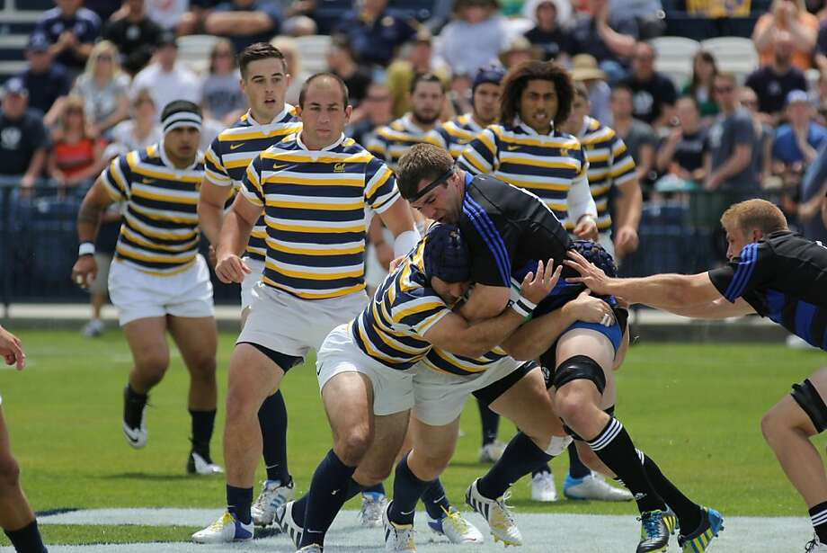 Cal's Seamus Kelly helps tackle BYU captain Ryan Roundy in the Varsity Cup.