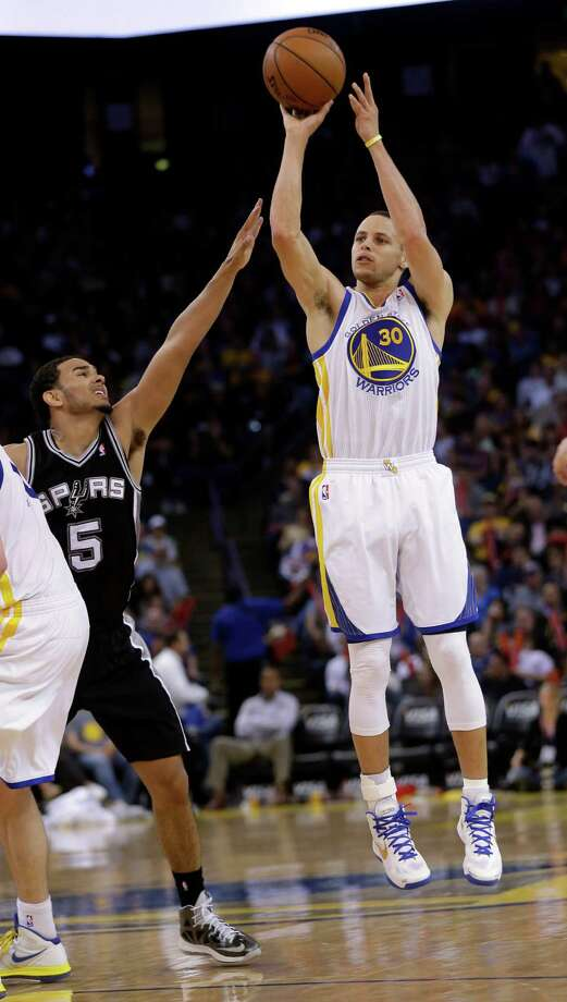 Golden State guard Stephen Curry, right, burned Cory Joseph and the Spurs for 35 points, including seven 3-pointers, in the Warriors' 116-106 victory April 15. Photo: Marcio Jose Sanchez, STF / AP
