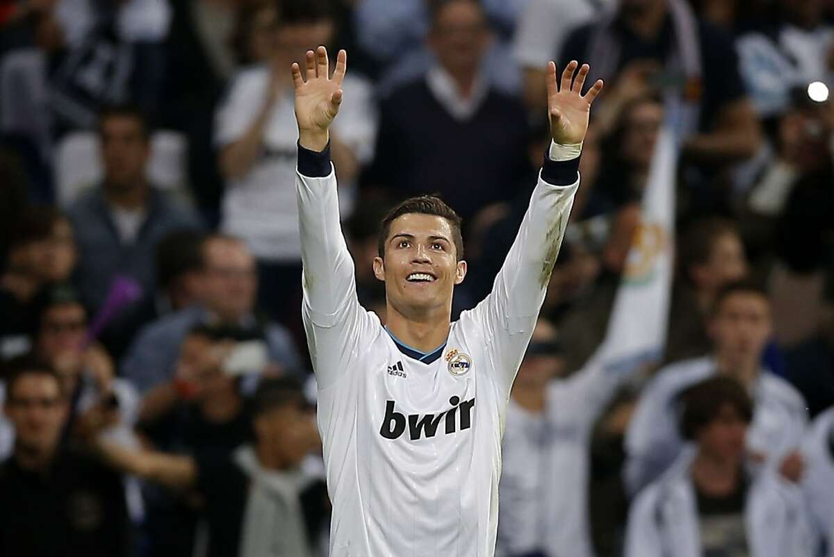 Real Madrid's Cristiano Ronaldo from Portugal celebrates after scoring during a Spanish La Liga soccer match against Valladolid's at the Santiago Bernabeu stadium, in Madrid, Saturday, May 4, 2013. (AP Photo/Daniel Ochoa de Olza)