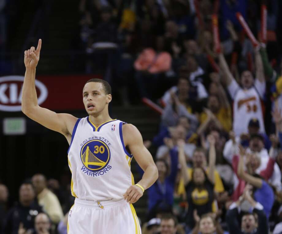 The Warriors' Stephen Curry celebrates after making a 3-pointer against the Spurs in Oakland on  April 15, 2013. Golden State won 116-106.