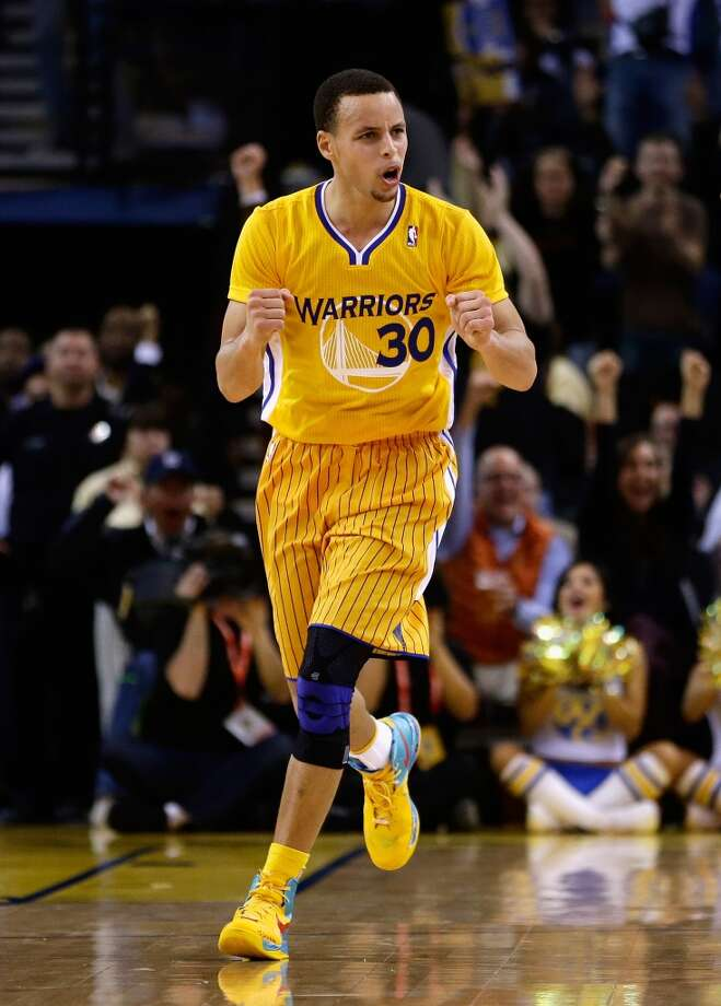 Stephen Curry of the Warriors reacts after the Warriors scored against the Spurs on Feb. 22, 2013 in Oakland.