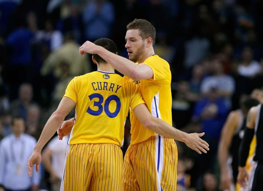 Stephen Curry (30) and David Lee of the Warriors celebrated during the final minute of their overtime win against the Spurs on Feb. 22, 2013 in Oakland.
