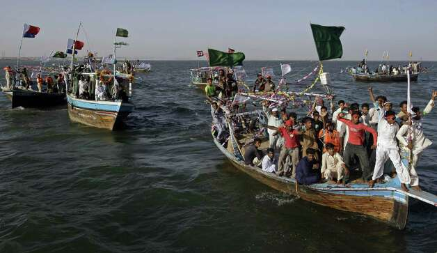 In this Friday, May 3, 2013 photo, supporters for an independent  Pakistani election candidate participate in a waterborne rally to highlight the challenges faced by their embattled fishing community in the Arabian Sea off the coast of Karachi, Pakistan.(AP Photo/Fareed Khan) Photo: Fareed Khan, Associated Press / AP