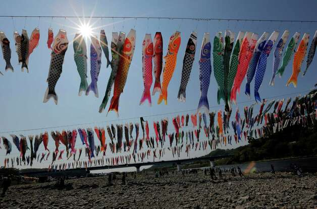 Colorful carp streamers flutter in the air over the Sagami River in Sagamihara, west of Tokyo, Saturday, May 4, 2013, ahead of Children's Day national holiday on May 5. It is a national tradition in Japan to fly carp streamers on the Children's Day. (AP Photo/Itsuo Inouye) Photo: Itsuo Inouye, Associated Press / AP