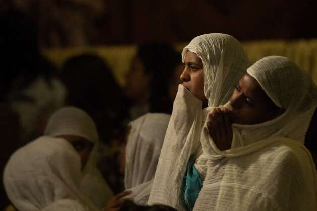 Ethiopian Christian orthodox women attend Easter mass led by of Egypt's Coptic Christian, Pope Tawadros II at the Saint Mark's Coptic Cathedral, in Cairo's al-Abbassiya district late on May 4, 2013. AFP PHOTO / KHALED DESOUKI Photo: KHALED DESOUKI, AFP/Getty Images / AFP