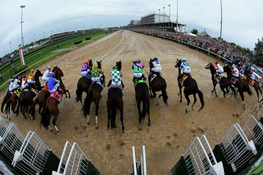 LOUISVILLE, KY - MAY 04:  The field comes out of the starter's gate to start the 139th running of the Kentucky Derby at Churchill Downs on May 4, 2013 in Louisville, Kentucky. Photo: Doug Pensinger, Getty Images / 2013 Getty Images