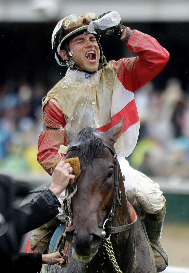 Joel Rosario celebrates after riding Orb to victory in the 139th Kentucky Derby at Churchill Downs Saturday, May 4, 2013, in Louisville, Ky. (AP Photo/David Goldman) Photo: David Goldman, Associated Press / AP