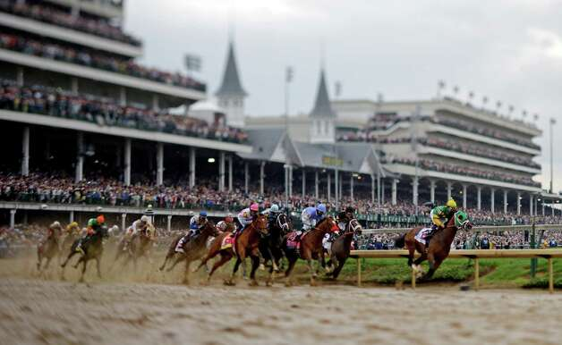 In this image made with a specialty lens, horses make their way around turn one during the 139th Kentucky Derby at Churchill Downs Saturday, May 4, 2013, in Louisville, Ky. (AP Photo/Matt Slocum) Photo: Matt Slocum, Associated Press / AP
