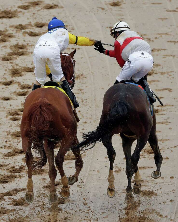 Joel Rosario, right, riding Orb is congratulated by Robby Albarado riding Golden Soul after Orb won  the 139th Kentucky Derby at Churchill Downs Saturday, May 4, 2013, in Louisville, Ky. (AP Photo/Charlie Riedel) Photo: Charlie Riedel, Associated Press / AP
