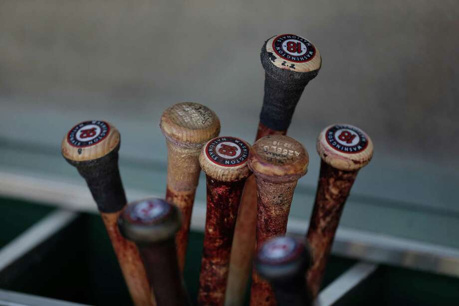 Washington Nationals bats sit in the bat rack in the dugout at PNC Park before a baseball game against the Pittsburgh Pirates in Pittsburgh Saturday, May 4, 2013. (AP Photo/Gene J. Puskar) Photo: Gene J. Puskar, Associated Press / AP