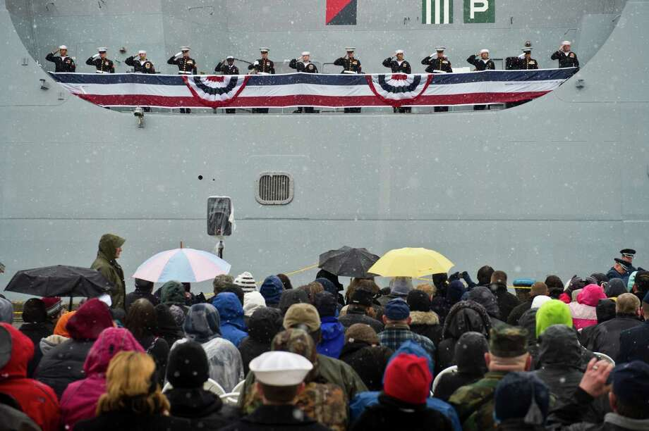 Sailors and Marines salute from the USS Anchorage at the conclusion of the commissioning ceremony Saturday, May 4, 2013 in Anchorage, Alaska. Several thousand gathered at the Port of Anchorage for the commissioning ceremony for the Navy's newest ship, the USS Anchorage.   (AP Photo/The Anchorage Daily News, Marc Lester) Photo: Marc Lester, Associated Press / Anchorage Daily News