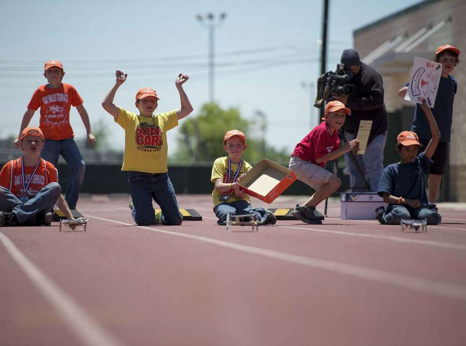 Competitors cheer after launching their hand-built solar-powered cars during the Texas Solar Race Car Event. Sixty-two of Northside ISD's 70 elementary schools participated this year. Photo: Darren Abate / For The San Antonio Express-News